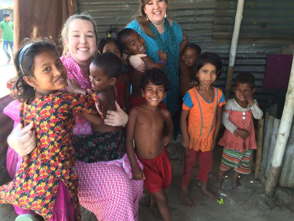 Visiting with children in a Dhaka slum.
